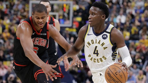 <p>               Indiana Pacers' Victor Oladipo (4) goes to the basket past Chicago Bulls' Cristiano Felicio (6) during the second half of an NBA basketball game Wednesday, Jan. 29, 2020, in Indianapolis. (AP Photo/Darron Cummings)             </p>