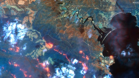 <p>               This satellite photo provided by Maxar Technologies shows wildfires spreading in the area south of Eden and Twofold Bay, shown in black, in New South Wales state of Australia, Sunday, Jan. 12, 2020. (Satellite image ©2020 Maxar Technologies via AP)             </p>