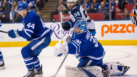 <p>               Toronto Maple Leafs goaltender Frederick Andersen (31) makes a save as defenseman Morgan Rielly (44) and Winnipeg Jets center Jansen Harkins (58) look on during the first period of an NHL hockey game, Wednesday, Jan. 8, 2020 in Toronto.(Frank Gunn/The Canadian Press via AP)             </p>