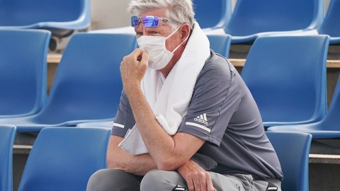 "<p>               A spectator wears a mask as smoke haze shrouds Melbourne during an Australian Open practice session at Melbourne Park in Australia, Tuesday, Jan. 14, 2020. Smoke haze and poor air quality caused by wildfires temporarily suspended practice sessions for the Australian Open at Melbourne Park on Tuesday, but qualifying began later in the morning in ""very poor"" conditions and amid complaints by at least one player who was forced to forfeit her match. (Michael DodgeAAP Image via AP)             </p>"