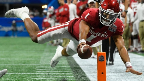 <p>               FILE - In this Dec. 28, 2019, file photo, Oklahoma quarterback Jalen Hurts (1) scores a touchdown against LSU during the second half of the Peach Bowl NCAA semifinal college football playoff game, in Atlanta. Hurts, the Heisman Trophy runner-up who once starred for Alabama, is hoping to improve his NFL draft stock at the Senior Bowl. (AP Photo/John Amis, File)             </p>