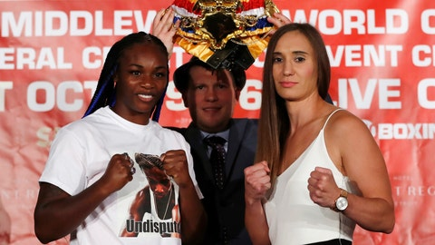 <p>               FILE - In this Aug. 14, 2019, file photo, Claressa Shields, left, stands with Ivana Habazin and promotor Dmitriy Salita during a press conference in Detroit. Claressa Shields tries for a third time to win a world title in three divisions. The first bout against Ivana Habazin was scratched because Shields injured her knee in training. The second attempt, well, even for the wacky world of boxing weigh-ins, this one went off the rails. Habazin's trainer was struck by Shields' brother and hospitalized: Artis Mack was charged with assault and the fight again was postponed. Shields and Habazin have kept the week leading up to Saturday's 154-pound fight in Atlantic City, New Jersey free of drama or any other distractions that could cancel the bout. (AP Photo/Carlos Osorio, File)             </p>