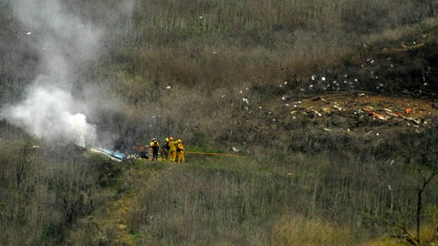 <p>               Firefighters work the scene of a helicopter crash where former NBA star Kobe Bryant died, Sunday, Jan. 26, 2020, in Calabasas, Calif. (AP Photo/Mark J. Terrill)             </p>