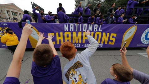 <p>               LSU fans cheer as players ride on floats during a parade celebrating LSU's NCAA college football championship, Saturday, Jan. 18, 2020, on the LSU campus in Baton Rouge, La. (AP Photo/Gerald Herbert)             </p>