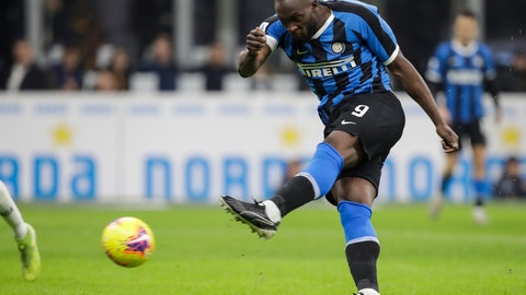 <p>               Inter Milan's Romelu Lukaku fires a shot during a Serie A soccer match between Inter Milan and Genoa, at the San Siro stadium in Milan, Italy, Saturday, Dec. 21, 2019. (AP Photo/Luca Bruno)             </p>