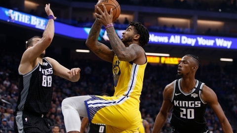 <p>               Golden State Warriors forward Marquese Chriss, center, goes to the basket between Sacramento Kings Nemanja Bjelica, left, and Harry Giles III, right, during the first quarter of an NBA basketball game in Sacramento, Calif., Monday, Jan. 6, 2020. (AP Photo/Rich Pedroncelli)             </p>