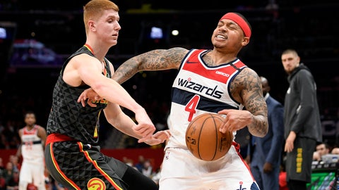 <p>               Atlanta Hawks guard Kevin Huerter (3) reaches for the ball next to Washington Wizards guard Isaiah Thomas (4) during the first half of an NBA basketball game, Friday, Jan. 10, 2020, in Washington. (AP Photo/Nick Wass)             </p>