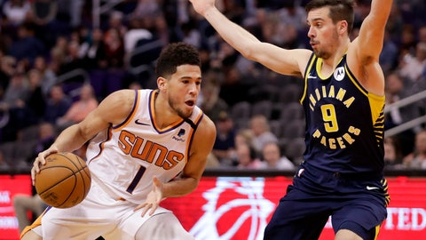 <p>               Phoenix Suns guard Devin Booker (1) drives as Indiana Pacers guard T.J. McConnell (9) defends during the second half of an NBA basketball game, Wednesday, Jan. 22, 2020, in Phoenix. (AP Photo/Matt York)             </p>