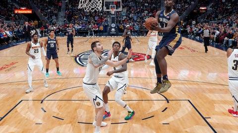 <p>               New Orleans Pelicans forward Zion Williamson (1) goes to the basket over Denver Nuggets forward Juan Hernangomez, left, and forward Jarred Vanderbilt in the first half of an NBA basketball game in New Orleans, Friday, Jan. 24, 2020. (AP Photo/Gerald Herbert)             </p>