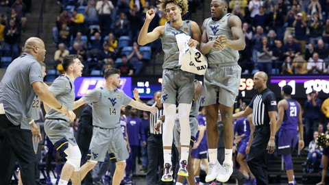 <p>               West Virginia forwards Emmitt Matthews Jr. (11) and Oscar Tshiebwe (34) celebrate after a score during the first half of the team's NCAA college basketball game against TCU on Tuesday, Jan. 14, 2020, in Morgantown, W.Va. (AP Photo/Kathleen Batten)             </p>