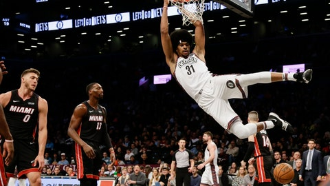 <p>               Brooklyn Nets' Jarrett Allen (31) dunks in front of Miami Heat's Bam Adebayo (13), Meyers Leonard (0) and Tyler Herro (14) during the second half of an NBA basketball game Friday, Jan. 10, 2020, in New York. The Nets won 117-113. (AP Photo/Frank Franklin II)             </p>