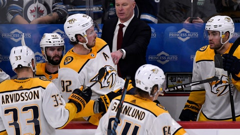 <p>               Nashville Predators head coach John Hynes, top center, instructs players during third-period NHL hockey game action against the Winnipeg Jets in Winnipeg, Manitoba, Sunday Jan. 12, 2020. (Fred Greenslade/The Canadian Press via AP)             </p>