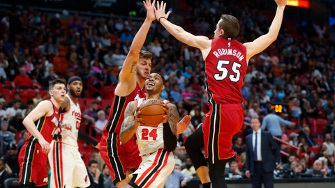 <p>               Portland Trail Blazers guard Kent Bazemore (24) goes up to shoot against Miami Heat forwards Duncan Robinson (55) and Meyers Leonard during the first half of an NBA basketball game, Sunday, Jan. 5, 2020, in Miami. (AP Photo/Wilfredo Lee)             </p>