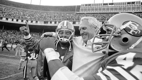 <p>               FILE - In this Nov. 29, 1981 file photo, San Francisco 49ers coach Bill Walsh is hugged by 49ers back Walt Easley, left, and 49ers back Ronnie Lott after beating the New York Giants 17-10 to clinch the division title at Candlestick Park in San Francisco. What doach Kyle Shanahan, quarterback Jimmy Garoppolo, defensive end Nick Bosa and the rest of the San Francisco 49ers are doing this year harkens back to 1981 when Bill Walsh, Joe Montana and Ronnie Lott led the franchise to its first Super Bowl title. (AP Photo/Carl Viti)             </p>