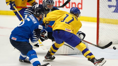 <p>               Finland's Mikko Kokkonen, left, and Finland's Justus Annunen, center, fail to stop Sweden's Samuel Fagemo, right, from scoring his sides second goal during the U20 Ice Hockey Worlds bronze medal match between Finland and Sweden in Ostrava, Czech Republic, Sunday, Jan. 5, 2020. (AP Photo/Petr David Josek)             </p>