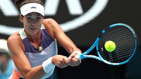 <p>               Spain's Garbine Muguruza makes a forehand return to Australia's Ajla Tomljanovic during their second round singles match at the Australian Open tennis championship in Melbourne, Australia, Thursday, Jan. 23, 2020. (AP Photo/Dita Alangkara)             </p>