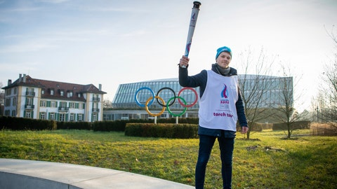 <p>               Nathanael Pianta poses with the Lausanne 2020 Youth Olympic Flame alongside the Olympic Rings outside Olympic House during the the final Torch Relay. The Winter Youth Olympic Games, Lausanne, Switzerland, Wednesday, Jan. 8, 2020. (Joel Marklund/Olympic Information Service via AP)             </p>