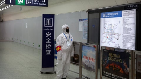 <p>               A worker wearing a hazardous materials suit stands at the entrance to a subway station in Beijing, Sunday, Jan. 26, 2020. The new virus accelerated its spread in China, and the U.S. Consulate in the epicenter of the outbreak, the central city of Wuhan, announced Sunday it will evacuate its personnel and some private citizens aboard a charter flight. (AP Photo/Mark Schiefelbein)             </p>