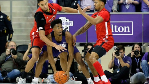 <p>               TCU guard RJ Nembhard, center, is double teamed by Texas Tech forward TJ Holyfield, left, and forward Tyreek Smith, right during the first half of an NCAA college basketball game in Fort Worth, Texas, Tuesday, Jan. 21, 2020. (AP Photo/Ray Carlin)             </p>
