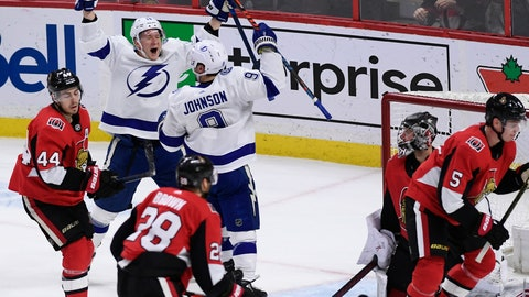 <p>               Tampa Bay Lightning center Tyler Johnson (9) celebrates his winning goal with left wing Ondrej Palat (18) as Ottawa Senators goaltender Craig Anderson (41) watches during third-period NHL hockey game action in Ottawa, Ontario, Saturday, Jan. 4, 2020. (Justin Tang/The Canadian Press via AP)             </p>