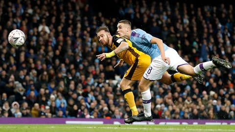 <p>               Port Vale's Tom Pope, left, scores his side's first goal of the game during the English FA Cup third round soccer match between Manchester City and Port Vale at the Etihad Stadium, Manchester, England, Saturday, Jan. 4, 2020. (Martin Rickett/PA via AP)             </p>