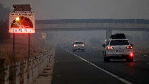 <p>               Cars drive down a freeway as smoke shrouds the Australian capital of Canberra, Australia, Wednesday, Jan. 1, 2020. Australia deployed military ships and aircraft to help communities ravaged by apocalyptic wildfires that destroyed homes and sent thousands of residents and holidaymakers fleeing to the shoreline. (AP Photo/Mark Baker)             </p>