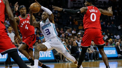 <p>               Charlotte Hornets guard Terry Rozier, center, drives between Toronto Raptors forward Rondae Hollis-Jefferson (4) and guard Terence Davis (0)during the first half of an NBA basketball game in Charlotte, N.C., Wednesday, Jan. 8, 2020. (AP Photo/Nell Redmond)             </p>
