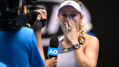 <p>               Denmark's Caroline Wozniacki wipes away tears after a third round loss to Tunisia's Ons Jabeur at the Australian Open tennis championship in Melbourne, Australia, Friday, Jan. 24, 2020. (AP Photo/Andy Brownbill)             </p>