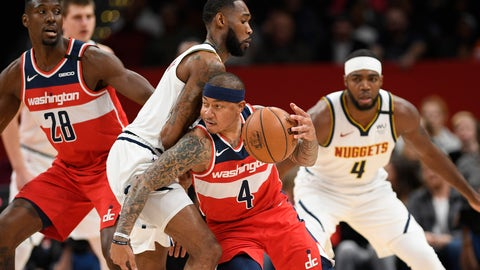 <p>               Washington Wizards guard Isaiah Thomas, right center, dribbles the ball next to Denver Nuggets guard Will Barton, left center, during the first half of an NBA basketball game, Saturday, Jan. 4, 2020, in Washington. Also seen is Wizards center Ian Mahinmi (28) and Nuggets forward Paul Millsap, back right. (AP Photo/Nick Wass)             </p>