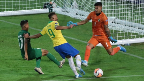 <p>               Brazil's Matheus Cunha, center, strikes the ball in an attempt to score against Bolivia during a South America Olympic qualifying U23 soccer match at Centenario stadium in Armenia, Colombia, Tuesday, Jan. 28, 2020. (AP Photo/Fernando Vergara)             </p>