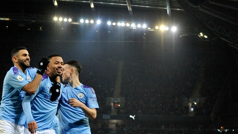<p>               Manchester City's Gabriel Jesus, center, celebrates with teammates after scoring his side's opening goal during the English Premier League soccer match between Manchester City and Everton at Etihad stadium in Manchester, England, Wednesday, Jan. 1, 2020. (AP Photo/Rui Vieira)             </p>
