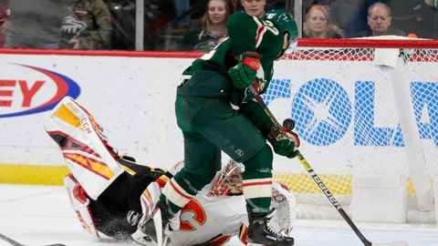 <p>               Calgary Flames goalie David Rittich (33) makes a stop on Minnesota Wild left wing Kevin Fiala in the third period during an NHL hockey game Sunday, Jan. 5, 2020, in St. Paul, Minn. The Flames defeated the Wild 5-4 in the shoot out. (AP Photo/Andy Clayton-King)             </p>