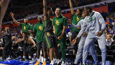<p>               Baylor guard Devonte Bandoo (2) celebrates with teammates on the bench after scoring a three-point basket during the second half of an NCAA college basketball game against Florida, Saturday, Jan. 25, 2020, in Gainesville, Fla. (AP Photo/Matt Stamey)             </p>