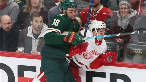<p>               Minnesota Wild's Jordan Greenway, left, checks Detroit Red Wings' Robby Fabbri in the first period of an NHL hockey game Wednesday, Jan. 22, 2020, in St. Paul, Minn. (AP Photo/Jim Mone)             </p>