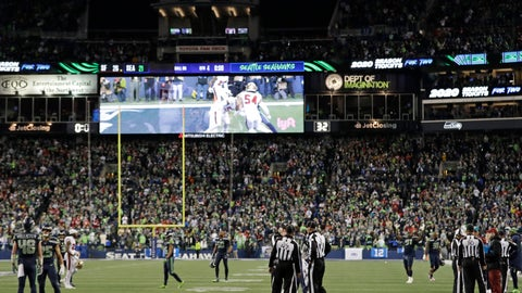 <p>               Officials stand on the field as a play involving Seattle Seahawks tight end Jacob Hollister (48) is reviewed late in the second half of an NFL football game against the San Francisco 49ers, Sunday, Dec. 29, 2019, in Seattle. Hollister was ruled down just inches away from the goal line on a fourth-and-goal play and the decision was upheld by the review. The 49ers won 26-21. (AP Photo/Ted S. Warren)             </p>