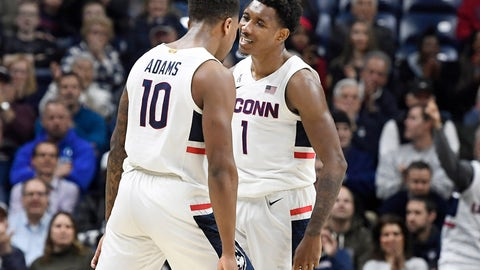 <p>               Connecticut's Brendan Adams (10) celebrates with Christian Vital (1) in the first half of an NCAA college basketball game against Temple, Wednesday, Jan. 29, 2020, in Storrs, Conn. (AP Photo/Jessica Hill)             </p>