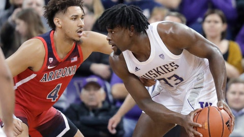 <p>               Arizona center Chase Jeter (4) pressures Washington forward Isaiah Stewart (33) during the first half of an NCAA college basketball game Thursday, Jan. 30, 2020, in Seattle. (AP Photo/Ted S. Warren)             </p>