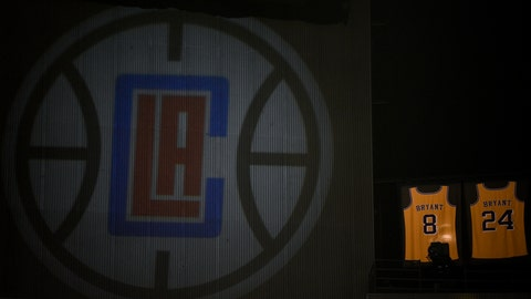 <p>               The retired jerseys of late Los Angeles Lakers' Kobe Bryant hangs above the arena next to a projected logo of the Los Angeles Clippers prior to an NBA basketball game against the Sacramento Kings in Los Angeles, Thursday, Jan. 30, 2020. (AP Photo/Kelvin Kuo)             </p>