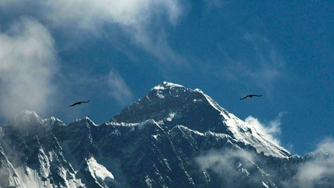 <p>               FILE - In this May 27, 2019, file photo, birds fly as Mount Everest is seen from Namche Bajar, Solukhumbu district, Nepal. Five climbers are attempting to scale Mount Everest, battling extreme cold, high winds and piled-up snow and ice as they try to become the first to reach the top of the world's highest mountain in the winter in 27 years, an official said Wednesday, Jan. 15, 2020. (AP Photo/Niranjan Shrestha, File)             </p>