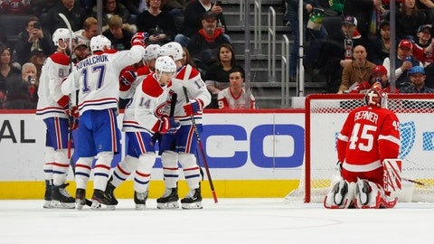 <p>               Montreal Canadiens center Nick Suzuki (14) celebrates his goal against Detroit Red Wings goaltender Jonathan Bernier (45) with teammates in the second period of an NHL hockey game Tuesday, Jan. 7, 2020, in Detroit. (AP Photo/Paul Sancya)             </p>