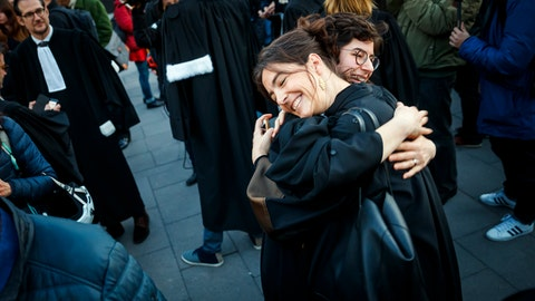 <p>               Lawyers Laila Batou, foreground hugs Marie-Pomme Moinat as they celebrate the non-guilty verdict of the trial of 12 pro-climate activists of the LAC collective (Lausanne Action Climat), in front of the tribunal of Renens, in Switzerland, Monday, Jan. 13, 2020.  A Swiss court on Monday threw out a case against a dozen climate activists who were on trial for storming a Credit Suisse office in Lausanne, Switzerland, and playing tennis inside — part of a protest against the bank's investments in fossil fuels that has ensnared its brand ambassador Roger Federer. (Valentin Flauraud/Keystone via AP)             </p>