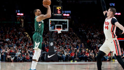 <p>               Milwaukee Bucks guard George Hill, left, shoots in front of Portland Trail Blazers forward Mario Hezonja during the second half of an NBA basketball game in Portland, Ore., Saturday, Jan. 11, 2020. (AP Photo/Craig Mitchelldyer)             </p>