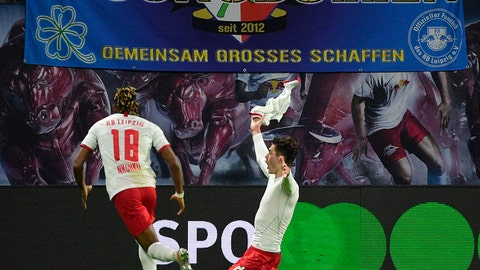 <p>               Leipzig's Patrik Schick, right, celebrates after scoring a goal during the German Bundesliga soccer match between RB Leipzig and FC Augsburg in Leipzig, Germany, Saturday, Dec. 21, 2019. (AP Photo/Jens Meyer)             </p>