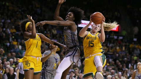 <p>               Baylor forward Lauren Cox, right, pulls down a rebound over West Virginia center Blessing Ejiofor, center, in the first half of an NCAA college basketball game, Saturday, Jan. 18, 2020, in Waco, Texas. (AP Photo/Rod Aydelotte)             </p>