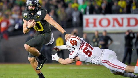 <p>               Oregon quarterback Justin Herbert runs for a touchdown past Wisconsin linebacker Jack Sanborn during second half of the Rose Bowl NCAA college football game Wednesday, Jan. 1, 2020, in Pasadena, Calif. (AP Photo/Mark J. Terrill)             </p>