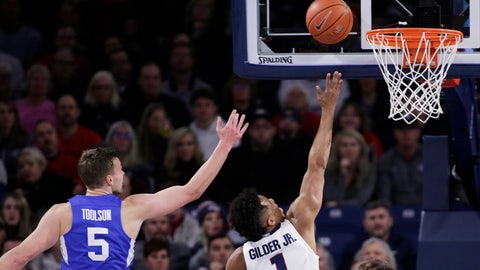 <p>               Gonzaga guard Admon Gilder (1) shoots in front of BYU guard Jake Toolson (5) during the first half of an NCAA college basketball game in Spokane, Wash., Saturday, Jan. 18, 2020. (AP Photo/Young Kwak)             </p>