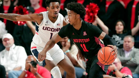 <p>               Houston guard Nate Hinton (11) drives around Connecticut guard Christian Vital (1) during the first half of an NCAA college basketball game Thursday, Jan. 23, 2020, in Houston. (AP Photo/Michael Wyke)             </p>