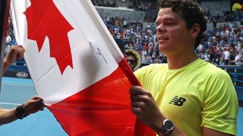 <p>               Canada's Milos Raonic signs his autograph onto a Canadian flag after defeating Croatia's Marin Cilic in their fourth round singles match at the Australian Open tennis championship in Melbourne, Australia, Sunday, Jan. 26, 2020. (AP Photo/Dita Alangkara)             </p>