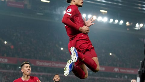 <p>               Liverpool's Virgil van Dijk jumps to celebrate scoring his side's first goal during the English Premier League soccer match between Liverpool and Manchester United at Anfield Stadium in Liverpool, Sunday, Jan. 19, 2020.(AP Photo/Jon Super)             </p>