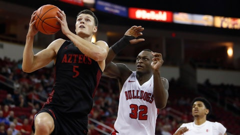 <p>               San Diego State's Yanni Wetzell drives past Fresno State's Nate Grimes during the second half of an NCAA college basketball game in Fresno, Calif., Tuesday Jan. 14, 2020. (AP Photo/Gary Kazanjian)             </p>